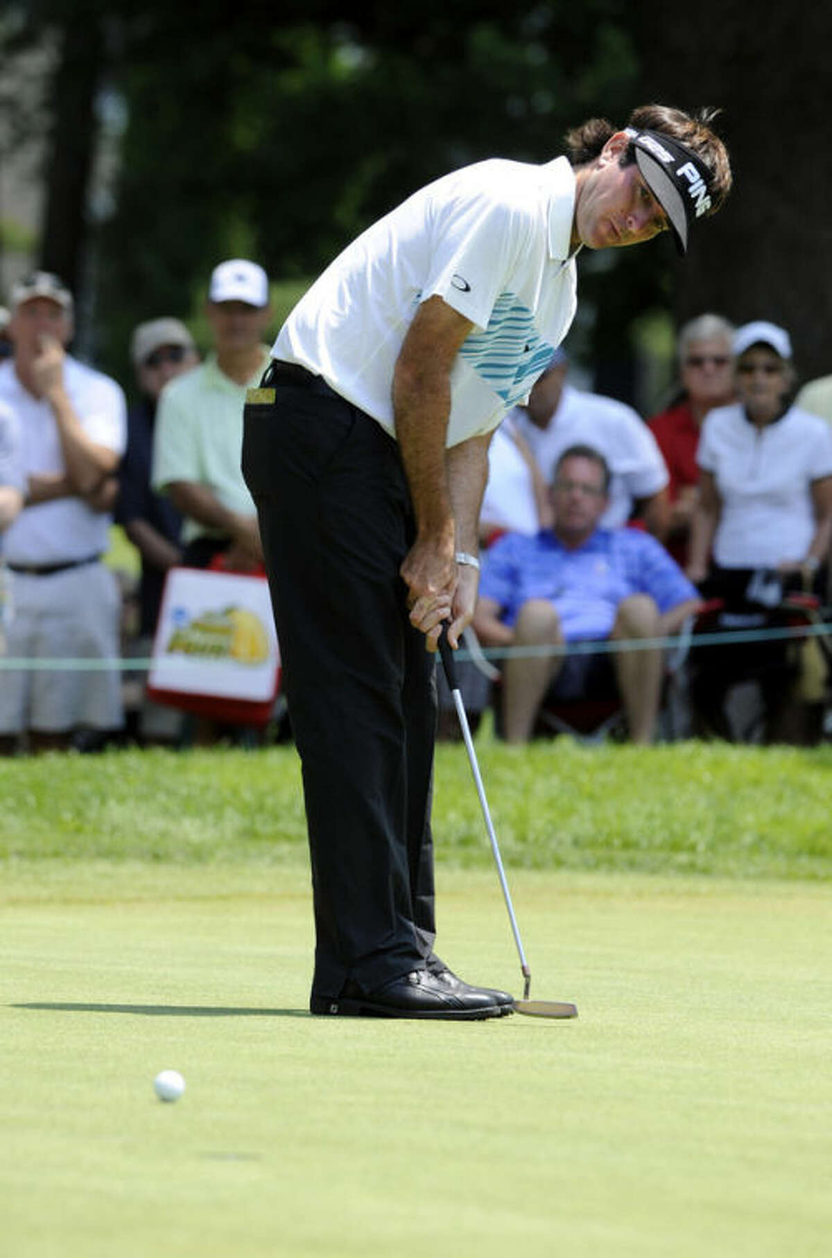 Bubba Watson watches his putt on the seventh green during the second round of the Travelers Championship golf tournament in Cromwell, Conn., Friday, June 21, 2013. Watson shot a 3-under par 67 in his round, to go 10-under par for the tournament. (AP Photo/Fred Beckham)