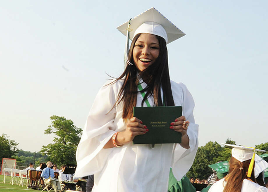 Jessica Jarimillo gets her diploma at the Norwalk High School graduation on Friday. Hour photo/Matthew Vinci