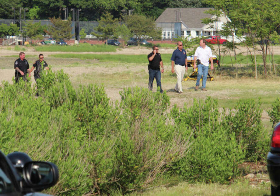 Hour photo by Chris BosakEmergency personnel at Cove Island Park in Stamford looking for a boy who was struggling under water.