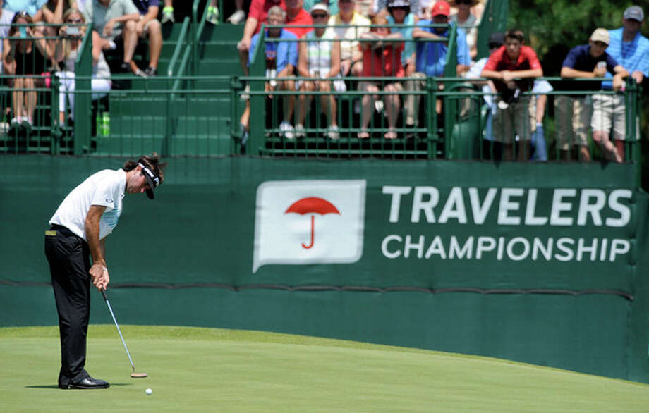 Bubba Watson watches his putt on the eighth green during the second round of the Travelers Championship golf tournament in Cromwell, Conn., Friday, June 21, 2013. Watson shot a 3-under par 67 in his round, to go 10-under par for the tournament. (AP Photo/Fred Beckham) / FR153656 AP