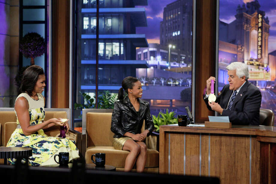 "This Monday, Aug. 13, 2012 photo released by NBC shows first lady Michelle Obama, left, olympic gold medalist Gabby Douglas and host Jay Leno during a taping of ""The Tonight Show with Jay Leno,"" in Burbank, Calif. (AP Photo/NBC, Margaret Norton) / NBC"