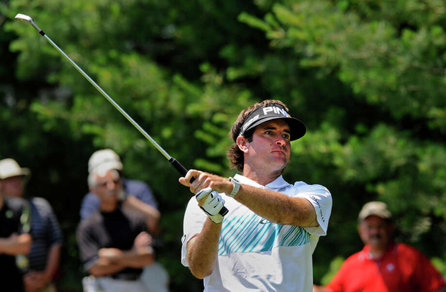 Bubba Watson watches his tee shot on the eighth hole during the second round of the Travelers Championship golf tournament in Cromwell, Conn., Friday, June 21, 2013. Watson shot a 3-under par 67 in his round, to go 10-under par for the tournament. (AP Photo/Fred Beckham) / FR153656 AP