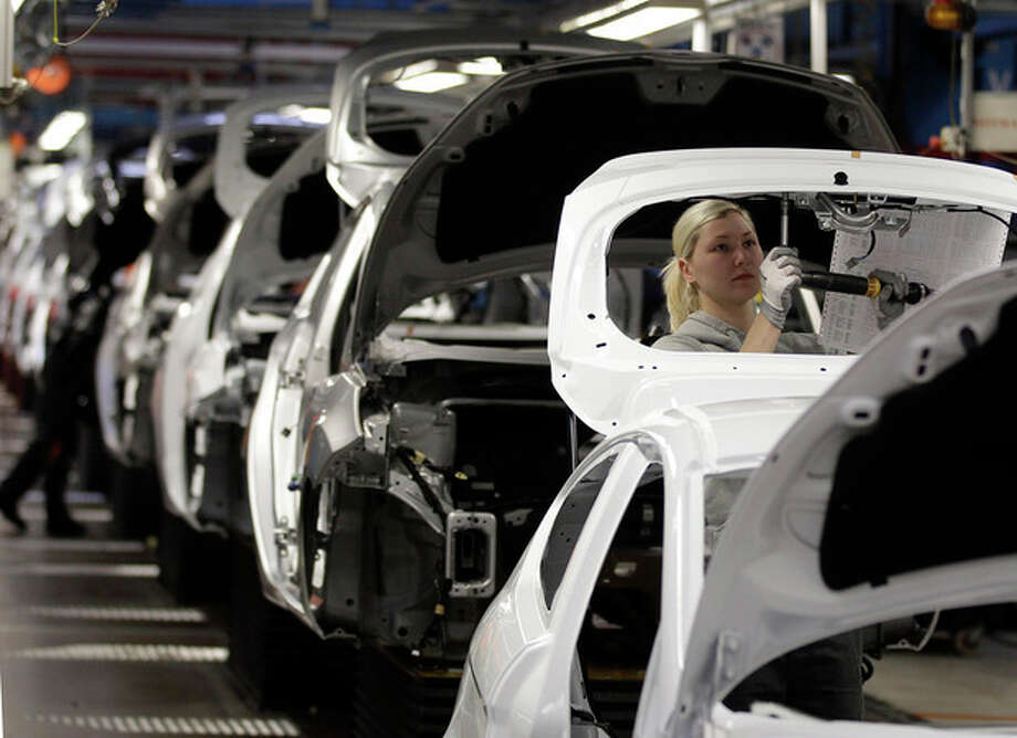 FILE - In this Feb. 9, 2012 file photo, workers build Ford Fiesta's at a Ford factory in Cologne, Germany. Germany's economy, Europe's largest, grew a larger-than-expected 0.3 per cent in the second quarter as consumer spending and strong exports helped stave off effects of the eurozone debt crisis, the Federal Statistical Office said Tuesday, Aug. 14, 2012. (AP Photo/Frank Augstein, File) / AP
