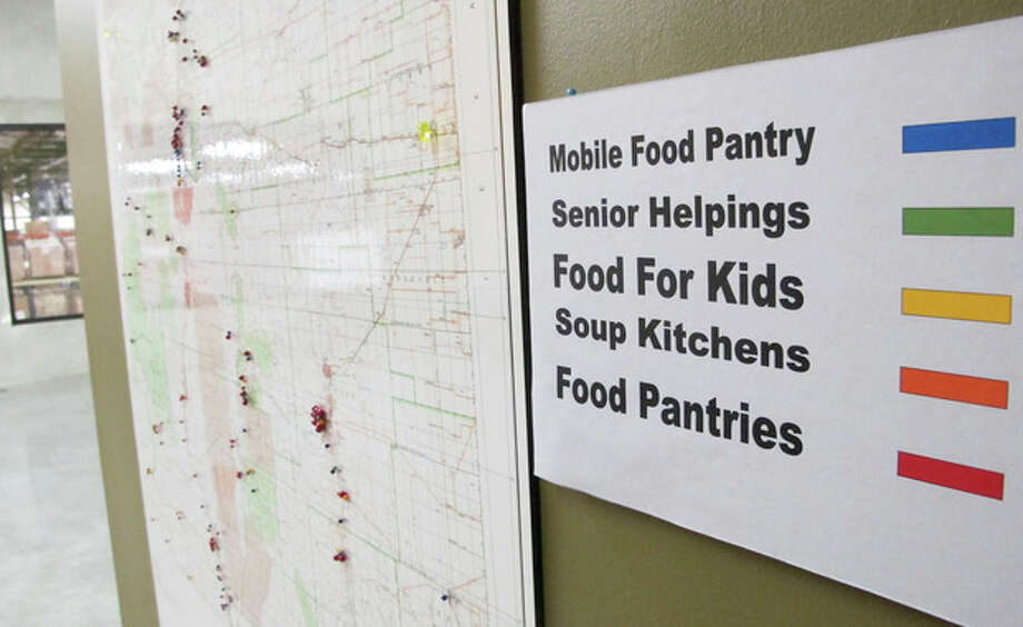 This June 21, 2013 image shows a map at Roadrunner Food Bank in Albuquerque, N.M., that depicts food distribution points across New Mexico. An annual survey released by the Annie E. Casey Foundation shows the number of children living in poverty increased to 23 percent in 2011. The survey ranks New Mexico as the worst in the nation when it comes to child well-being. (AP Photo/Susan Montoya Bryan) / AP