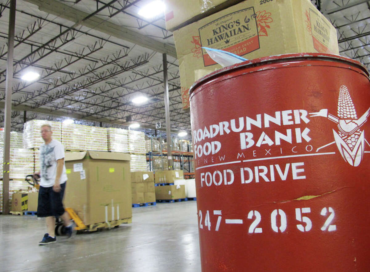 A volunteer moves a pallet of food at the Roadrunner Food Bank in Albuquerque, N.M., on Friday, June 21, 2013. The food bank distributes about 90,000 pounds of food a day to organizations that help low-income families. An annual survey released by the Annie E. Casey Foundation ranks New Mexico as worst in the nation when it comes to child well-being. More than 30 percent of children in the state were living in poverty in 2011. (AP Photo/Susan Montoya Bryan)