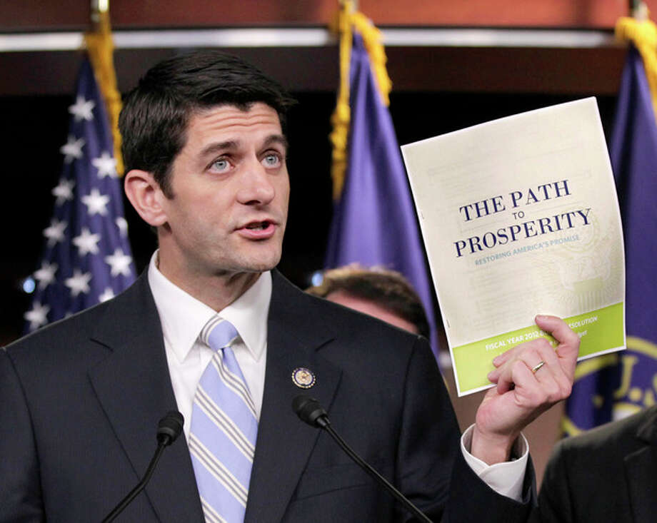 "FILE - In this April 5, 2011 file photo, Republican Vice Presidential candidate, current House Budget Committee Chairman Rep. Paul Ryan, R-Wis., introduces his controversial ""Path to Prosperity"" budget recommendations, on Capitol Hill in Washington. Paul Ryan traveled a perilous route to political stardom. While other lawmakers nervously whistled past trillion-dollar deficits, fearing to cut popular programs, he waded in with a machete and a smile. Ryan wants to slice away at Medicare, Social Security, food stamps and virtually every other government program but the military. (AP Photo/J. Scott Applewhite, File) / AP"