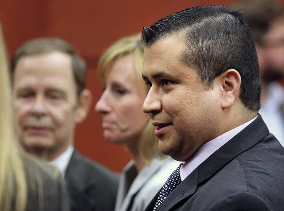George Zimmerman leaves court with his family after Zimmerman's not guilty verdict was read in Seminole Circuit Court in Sanford, Fla. on Saturday, July 13, 2013. Jurors found Zimmerman not guilty of second-degree murder in the fatal shooting of 17-year-old Trayvon Martin in Sanford, Fla. (AP Photo/Joe Burbank, Pool) / Orlando Sentinel POOL