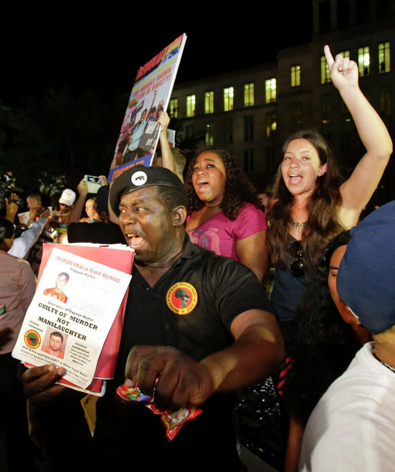 James Evan Muhammad, front left, of the New Black Panther Party, shouts slogans after the verdict of not guilty was handed down in the trial of George Zimmerman at the Seminole County Courthouse, Saturday, July 13, 2013, in Sanford, Fla. Neighborhood watch captain George Zimmerman was cleared of all charges Saturday in the shooting of Trayvon Martin, the unarmed black teenager whose killing unleashed furious debate across the U.S. over racial profiling, self-defense and equal justice. (AP Photo/John Raoux) / AP