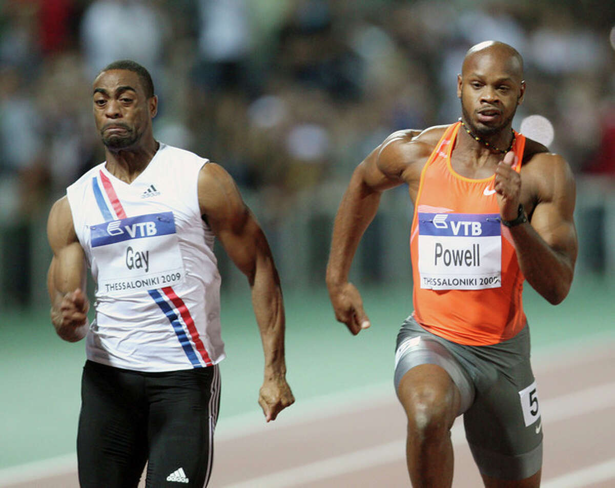 FILE - In this Sept. 12, 2009 file photo Tyson Gay, left, of the United States and Asafa Powell from Jamaica compete in men's 100 meters during an IAAF World Athletics Final at Thessaloniki's Kaftanzoglio stadium, Greece. Former 100-meter world-record holder Asafa Powell and Jamaican teammate Sherone Simpson have each tested positive for banned stimulants, according to their agent. Paul Doyle told The Associated Press on Sunday, July 14, 2013 that they tested positive for the stimulant oxilofrine at the Jamaican championships and were just recently notified. The news came the same day that American 100-meter record holder Tyson Gay revealed that he also failed a drug test. (AP Photo/Thannasis Stavrakis, File)