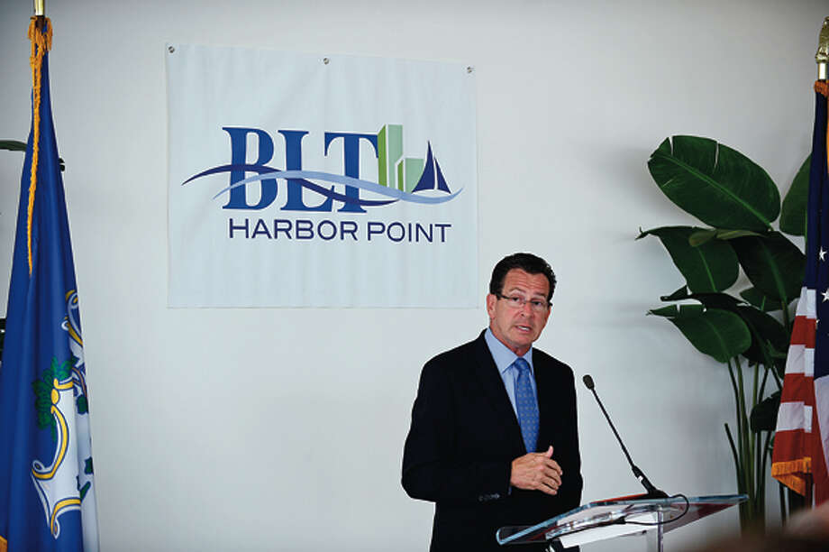 Governor Dannel Malloy speaks during a press event announcing the move of Bridgewater Associates to Building and Land Management's Harbor Point development in Stamford Wednesday. Hour photo / Erik Trautmann / (C)2012, The Hour Newspapers, all rights reserved