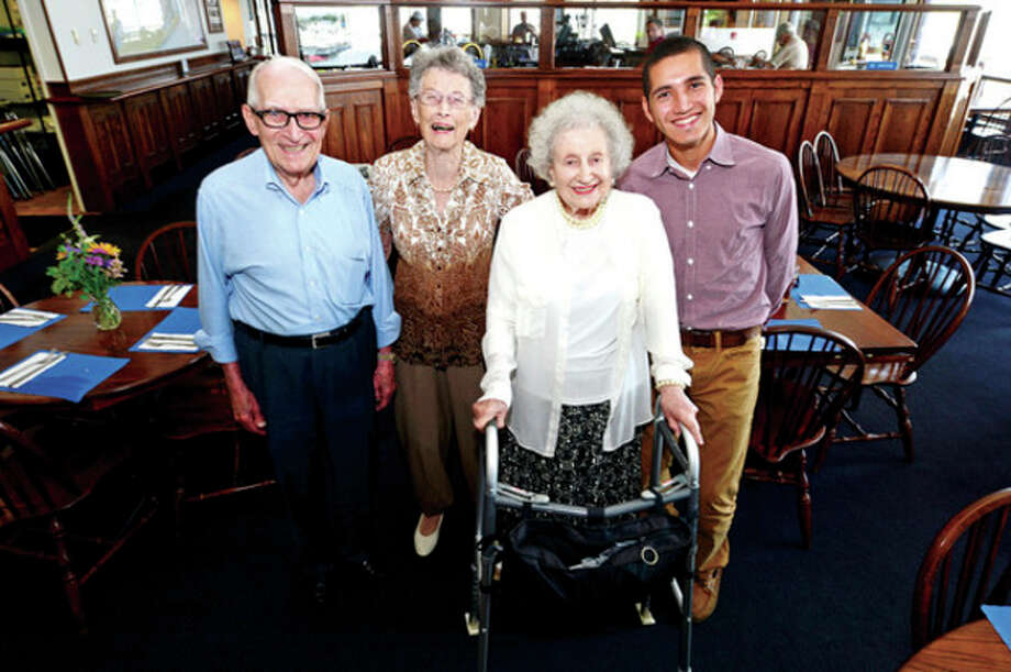 Hour photo / Erik TrautmannNorwalk High School Class of 1938 President Michael Errico with classmates Frances Clark and Mary Totorella DiScala with Class of 2013 President Edwin Rosales during the 1938 class reunion at the South Norwalk Boat Club Saturday. / (C)2013, The Hour Newspapers, all rights reserved