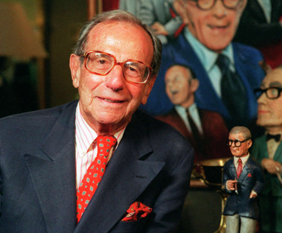 "FILE - This Oct. 6, 1996 file photo shows Irving Fein, long time manager of the late George Burns, standing near memorabilia up for auction at Sotheby's, in Beverly Hills, Calif. Fein, a producer and manager who steered the careers of George Burns and Jack Benny and nicknamed actress Lana Turner ""the Sweater Girl,"" died Aug. 10, 2012 of an age-related illness. He was 101. (AP Photo/Frank Wiese, file) / AP"