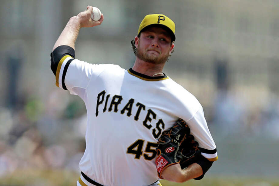 Pittsburgh Pirates starting pitcher Gerrit Cole delivers in the first inning of a baseball game against the New York Mets in Pittsburgh Sunday, July 14, 2013. (AP Photo/Gene J. Puskar) / AP