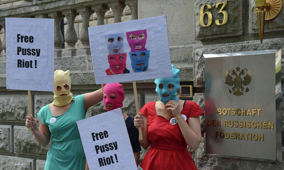Masked female activists demonstrate in support of members of the feminist punk group Pussy Riot in front of the Russian Embassy in Berlin, Germany, Thursday Aug. 9, 2012. Prosecutors in Russia on Tuesday called for three-year prison sentences for feminist punk rockers who gave an impromptu performance in Moscow's main cathedral to call for an end to Vladimir Putin's rule, in a case that has caused international outrage and split Russian society. (AP Photo/dapd/Oliver Lang) / DAPD
