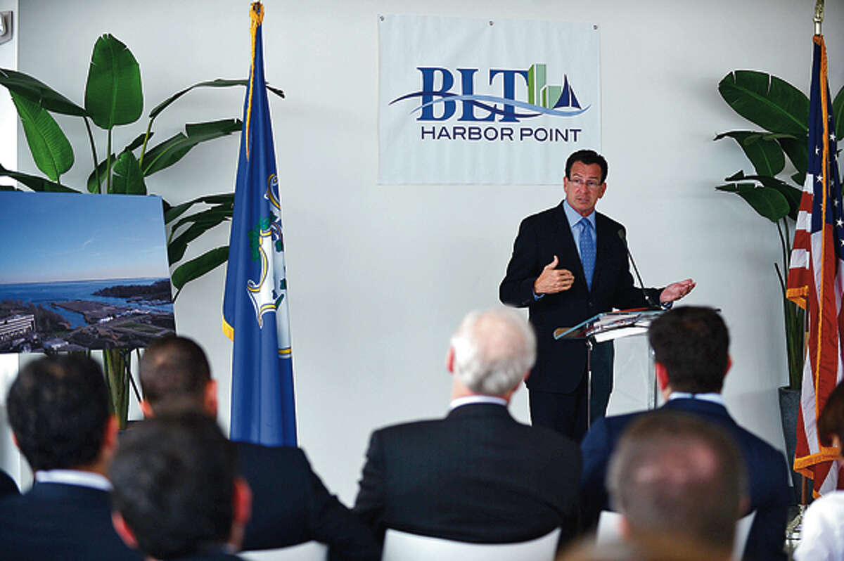 Governor Dannel Malloy speaks during a press event announcing the move of Bridgewater Associates to Building and Land Management's Harbor Point development in Stamford Wednesday. Hour photo / Erik Trautmann
