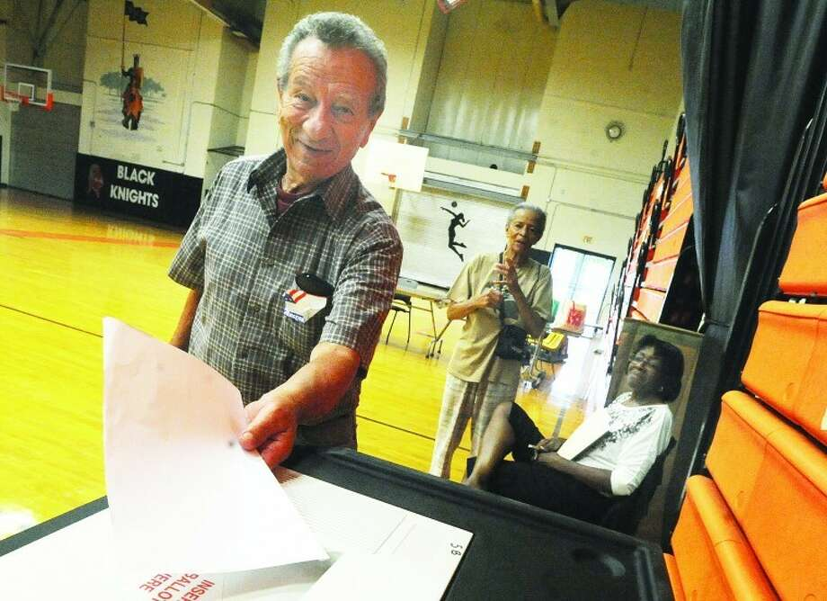 Ted Fiorderisi turns in his ballot Tuesday at Stamford High School District 5. photo/Matthew Vinci