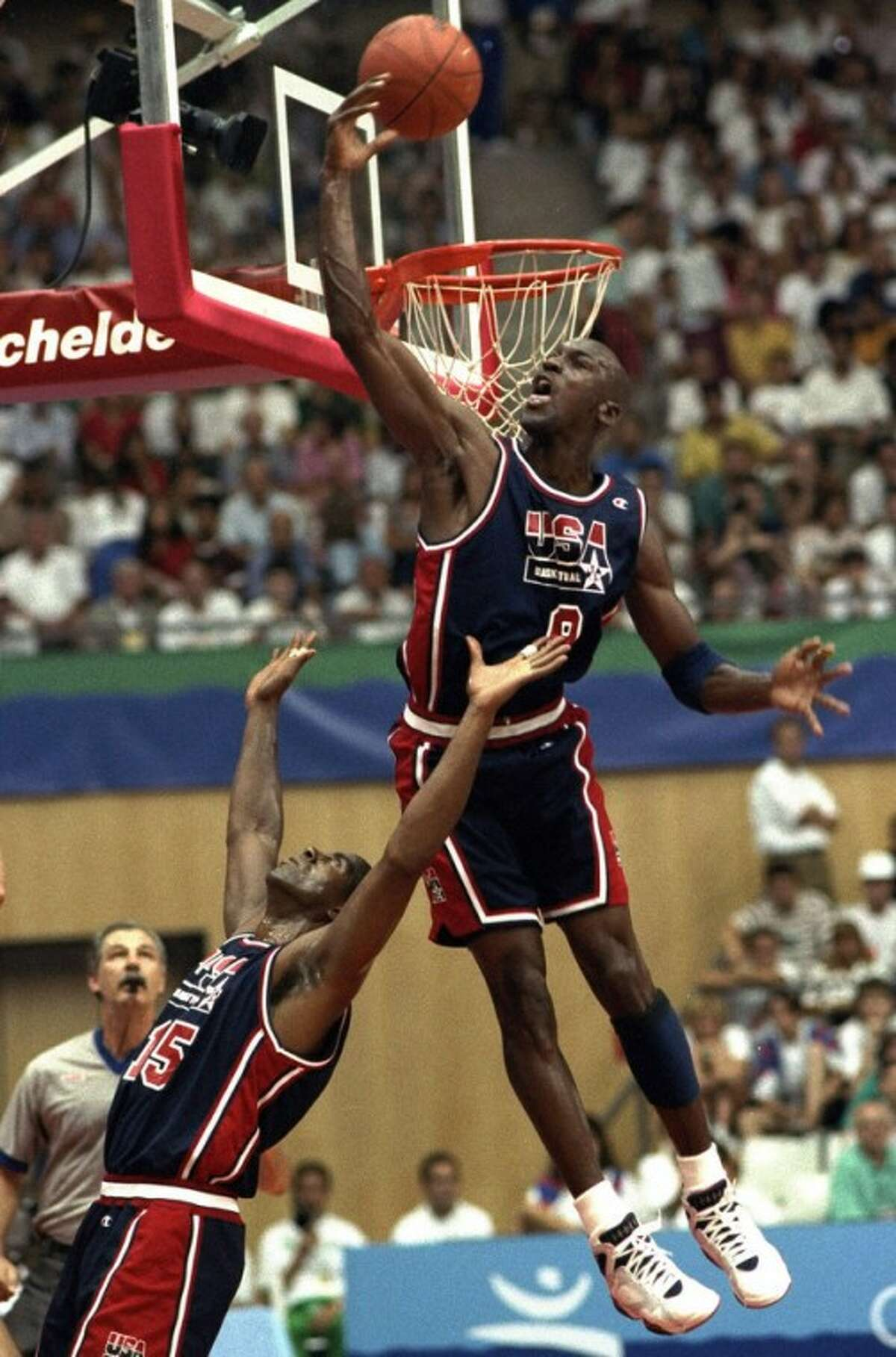FILE - In this July 27, 1992 file photo, USA's Michael Jordan sails high above teammate Magic Johnson knocking away a shot during the first half of their preliminary round basketball game with Croatia at the Summer Olympics in Barcelona. With USA Basketball and 2K Sports forming a partnership, fans can see what happens when the 1992 Dream Team goes up against this year's Olympic gold medal winner once NBA 2K13 hits the shelves this fall. (AP Photo/Susan Ragan, File)