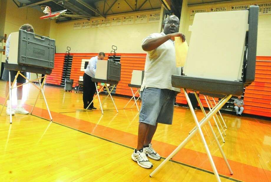 Delroy Francis votes Tuesday at Stamford High School District 5. photo/Matthew Vinci
