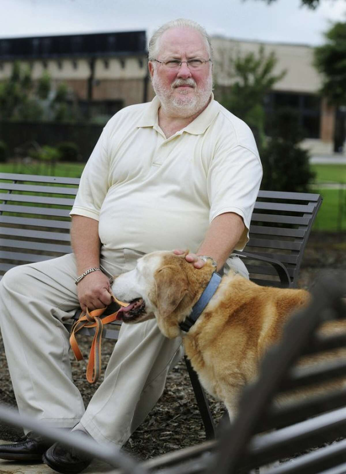 Greg Mann, an unemployed research analyst and real estate appraiser, sits with his dog Oz at a park near his home, Tuesday, Aug. 14, 2012, in Braselton, Ga.. The recession that ended three years ago lingers on as the worst economic recovery since the Great Depression. (AP Photo/John Amis)