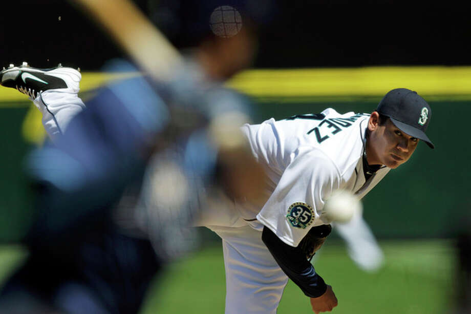 Seattle Mariners starting pitcher Felix Hernandez throws against the Tampa Bay Rays in the fourth inning of a baseball game, Wednesday, Aug. 15, 2012, in Seattle. (AP Photo/Ted S. Warren) / AP