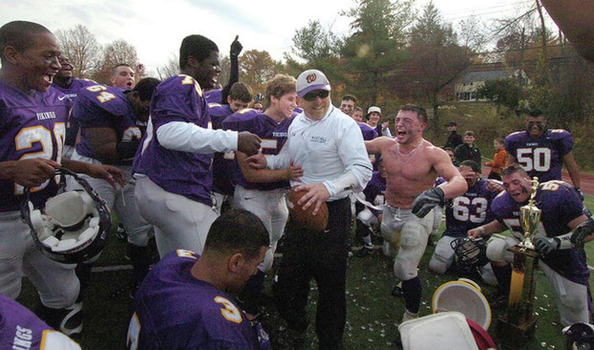 Westhills Coach Dick Cerone gets showered with Gatorade by his team photo Alex von Kleydorff file---12-02-07