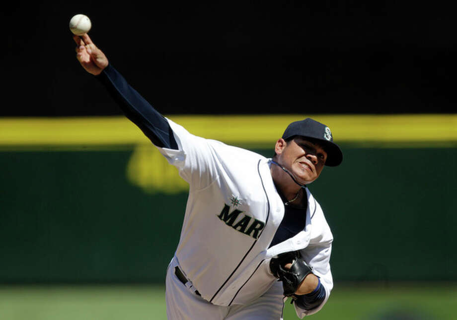 Seattle Mariners starting pitcher Felix Hernandez throws to a Tampa Bay Rays batter in the fourth inning of a baseball game, Wednesday, Aug. 15, 2012, in Seattle. (AP Photo/Ted S. Warren) / AP