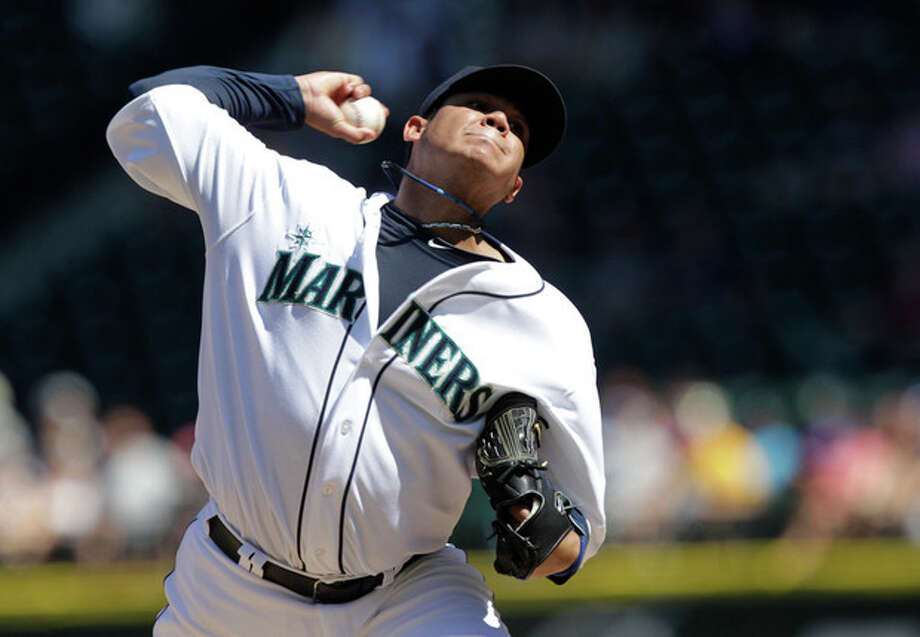 Seattle Mariners starting pitcher Felix Hernandez throws against the Tampa Bay Rays in the fifth inning of a baseball game on Wednesday, Aug. 15, 2012, in Seattle. (AP Photo/Ted S. Warren) / AP