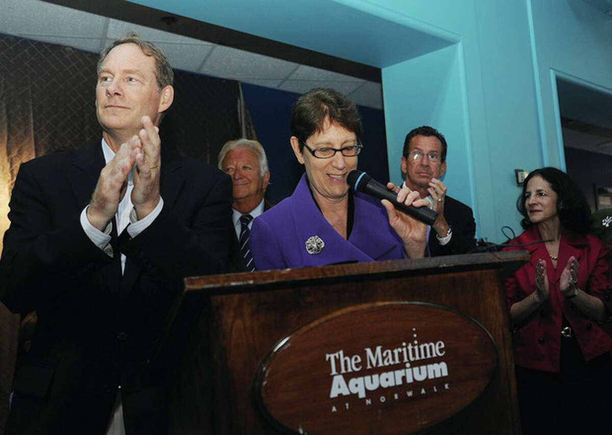 Hour photos / Matthew Vinci Jennifer Herring, president of The Maritime Aquarium at Norwalk, speaks as Robert Rohn, vice chairman and chairman of the executive committee, applauds during the Aquarium's 25th-anniversary celebration on Tuesday.