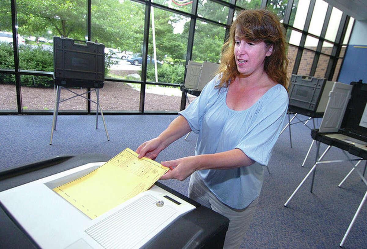 Hour Photo/ Alex von Kleydorff. Sarah Goldstein casts her vote at Wiltons district 1 during Tuesdays voting