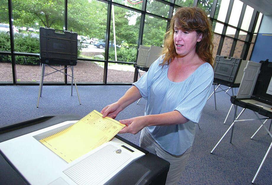 Hour Photo/ Alex von Kleydorff. Sarah Goldstein casts her vote at Wiltons district 1 during Tuesdays voting / 2012 The Hour Newspapers