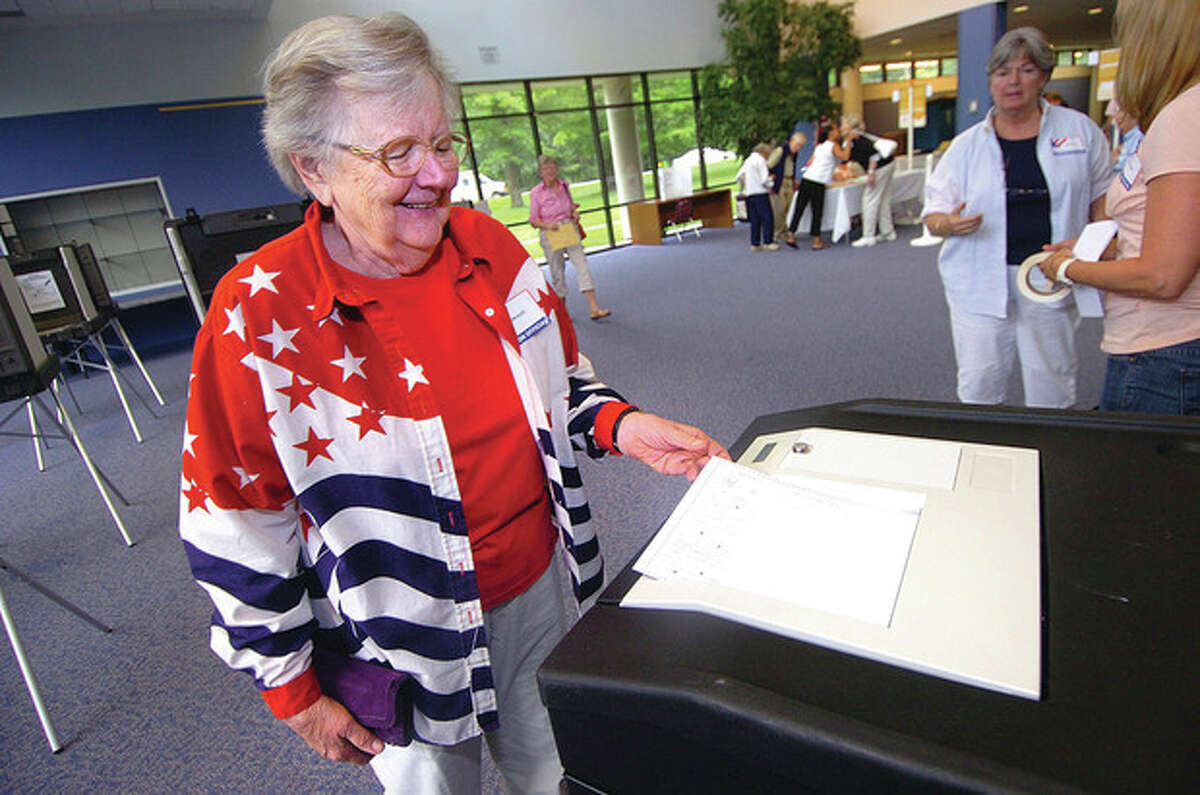 Hour Photo/ Alex von Kleydorff. Ann Klotz casts her vote at Wiltons district 1 during Tuesdays Primary voting