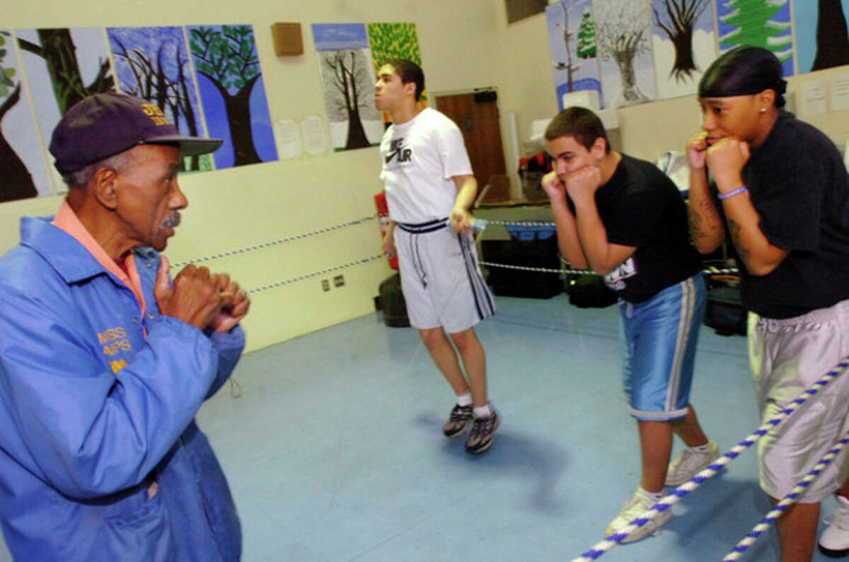 John Harris works with kids at his boxing workshop at Briggs school Wednesday/hour photo matthew vinci