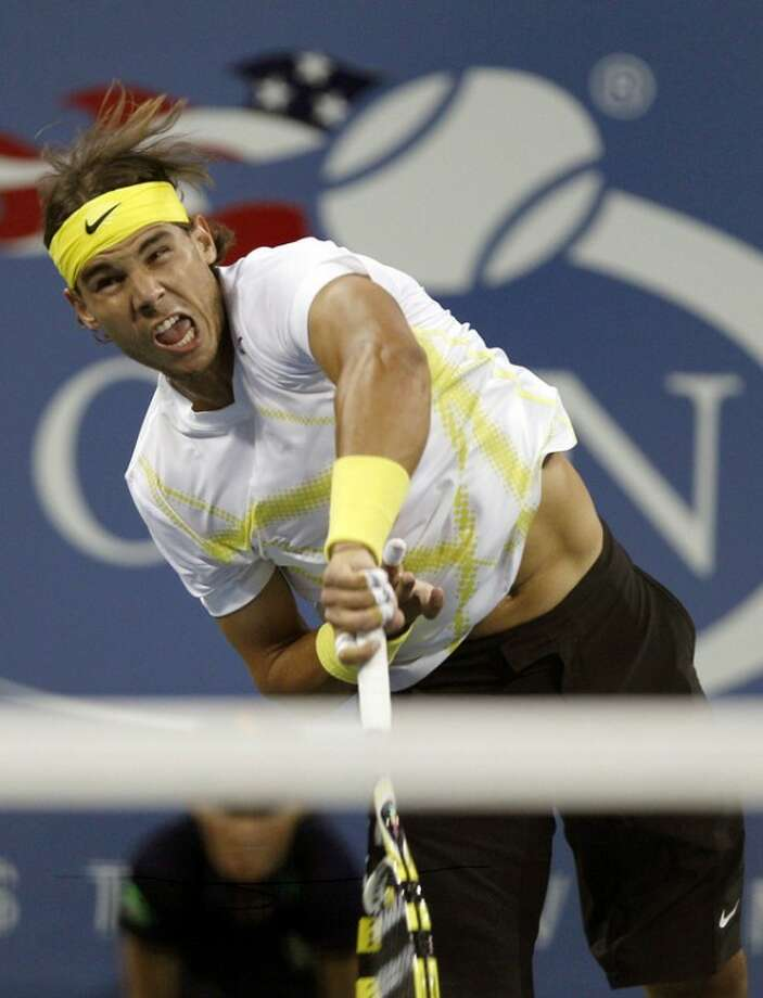 FILE - This Aug. 30, 2011 file photo shows Rafael Nadal, of Spain, serving to Andrey Golubev, of Kazakhstan, during the first round of the U.S. Open tennis tournament in New York. The U.S. Open says that Nadal has withdrawn from the last Grand Slam tennis tournament of the year because of injury. (AP Photo/Charles Krupa, File)