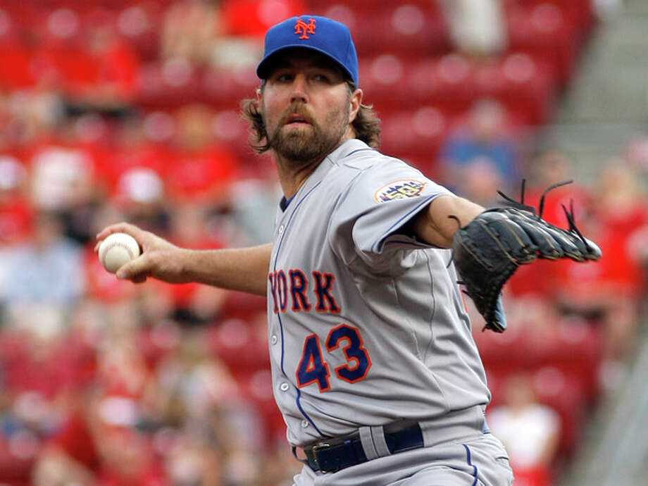 New York Mets starting pitcher R.A. Dickey throws against the Cincinnati Reds in the first inning during a baseball game, Wednesday, Aug. 15, 2012, in Cincinnati. (AP Photo/David Kohl) / FR51830 AP