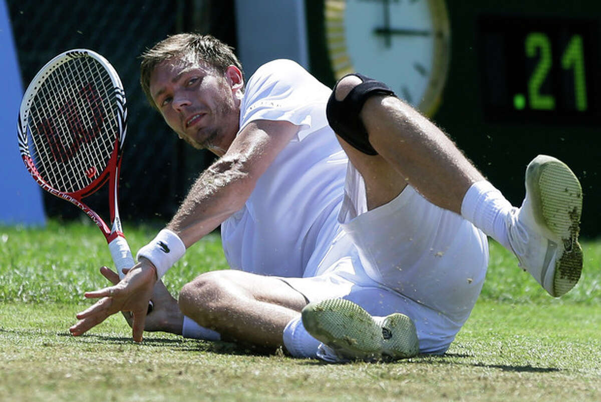 Nicolas Mahut, of France, falls during his match with Lleyton Hewitt, of Australia, in the finals of the Hall of Fame Tennis Championships in Newport, R.I., Sunday, July 14, 2013. (AP Photo/Elise Amendola)