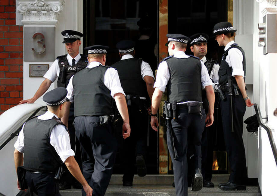 British police officers stand guard outside the Ecuadorian Embassy in central London, Thursday, Aug. 16, 2012. WikiLeaks founder Julian Assange entered the embassy in June in an attempt to gain political asylum to prevent him from being extradited to Sweden, where he faces allegations of sex crimes, which he denies. (AP Photo/Sang Tan) / AP