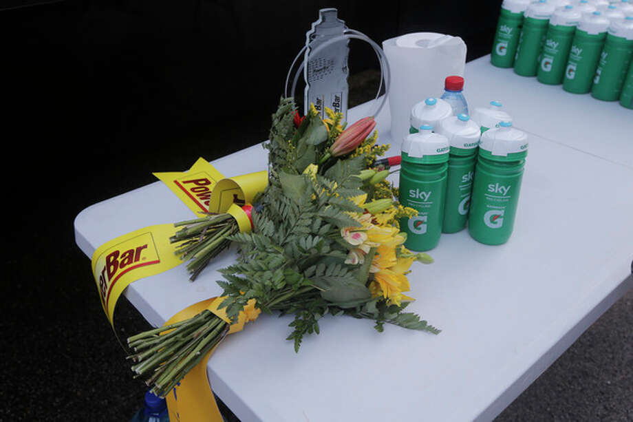 Christopher Froome of Britain's stage winner's trophy and flowers are displayed next to the Sky team drinking bottles on the rest day of the Tour de France cycling race in Orange, southern France, Monday July 15, 2013. (AP Photo/Laurent Cipriani) / AP