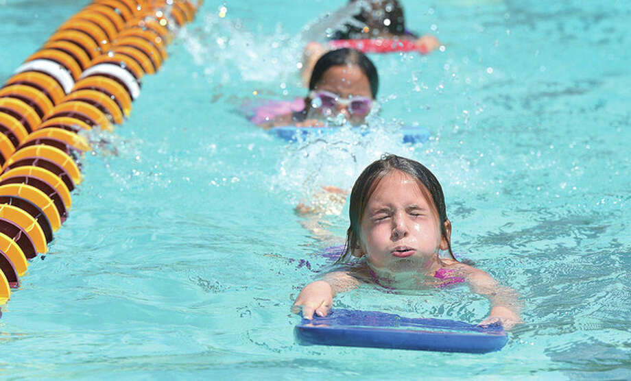 Hour Photo/Alex von Kleydorff 8yr old Caitlin Allen takes a breath during swim lessons in the pool at The Wilton Family Y Summer Camp Gordyland