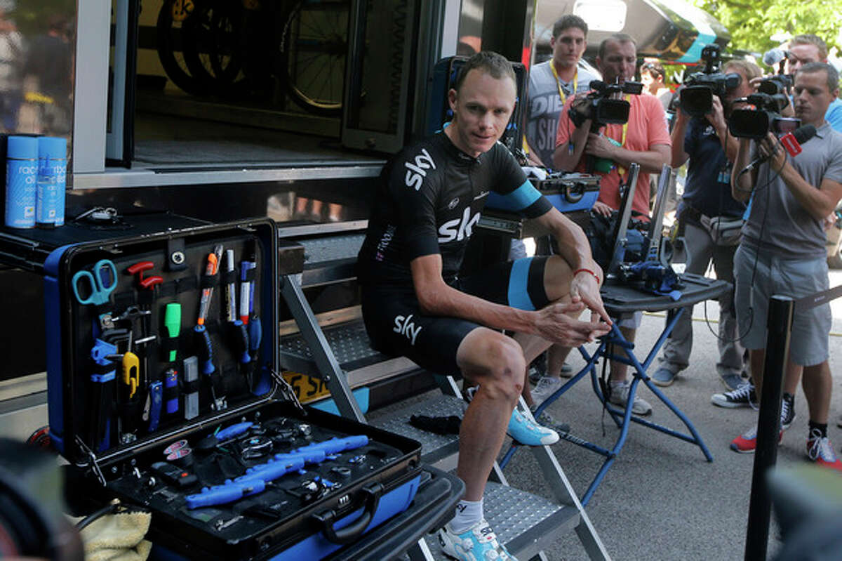 Overall leader Christopher Froome of Britain poses for photographers in a setup arranged by the Sky team press officer on the rest day of the Tour de France cycling race in Orange, southern France, Monday July 15, 2013. (AP Photo/Laurent Cipriani)