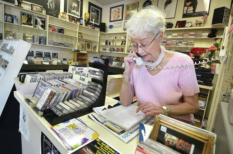 Hour photo / Alex von KleydorffSally White, owner of Sally's Place, looks for a Lester Young record for a customer.