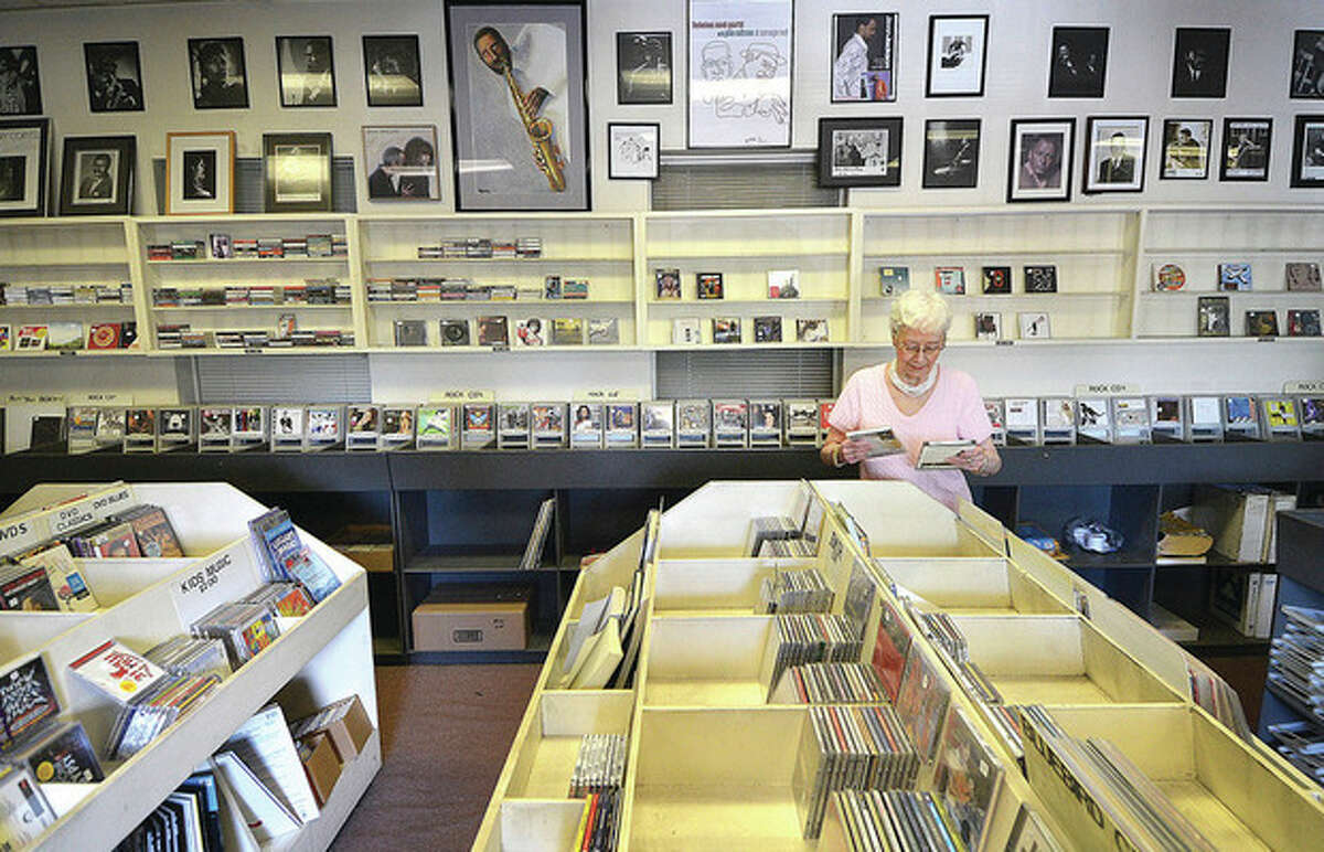 Hour photo / Alex von Kleydorff Sally's Place will close at the end of the summer, but owner Sally White still fills special orders as she starts to see empty spaces where records once filled the racks.