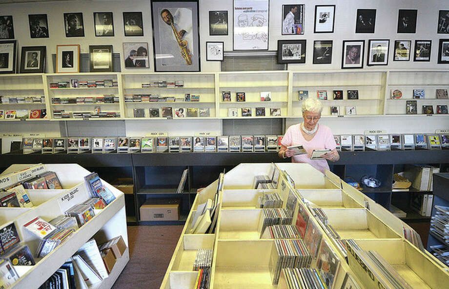 Hour photo / Alex von KleydorffSally's Place will close at the end of the summer, but owner Sally White still fills special orders as she starts to see empty spaces where records once filled the racks.