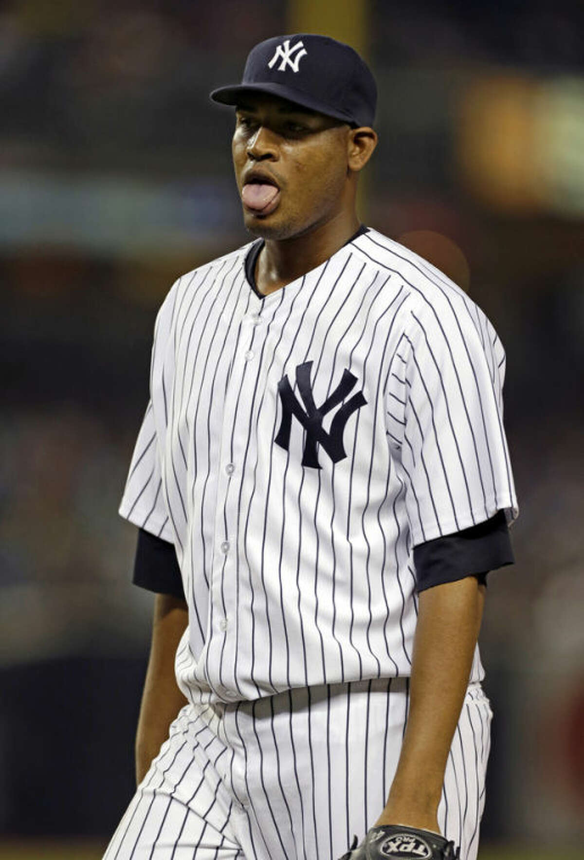 New York Yankees starting pitcher Ivan Nova reacts after getting out a jam in the fifth inning of a baseball game against the Kansas City Royals, Wednesday, July 10, 2013, in New York. (AP Photo/Kathy Willens)
