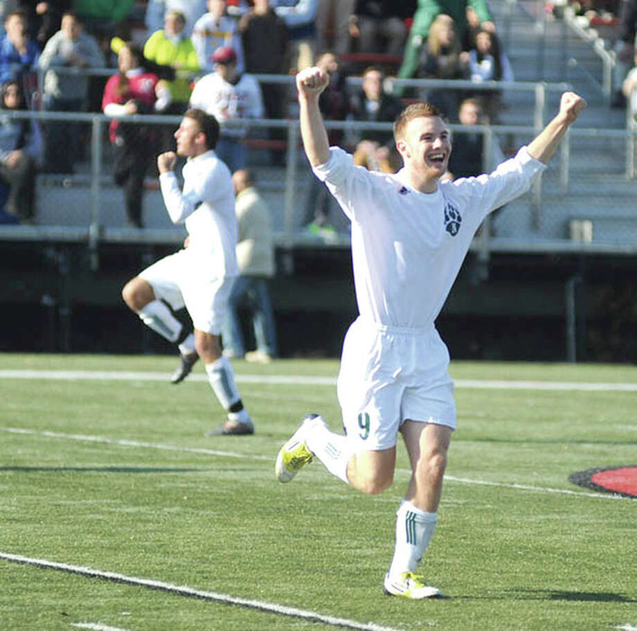 Hour photo/John NashNorwalk's Kevin Joslyn, right, and Andrew Melitsanopolous, rear left, run around Dunning Field after winning the state Class LL soccer championship last fall. For their run to Norwalk High's first soccer state title in 47 years, the Bears have been chosen as The Hour's high school team of the year.