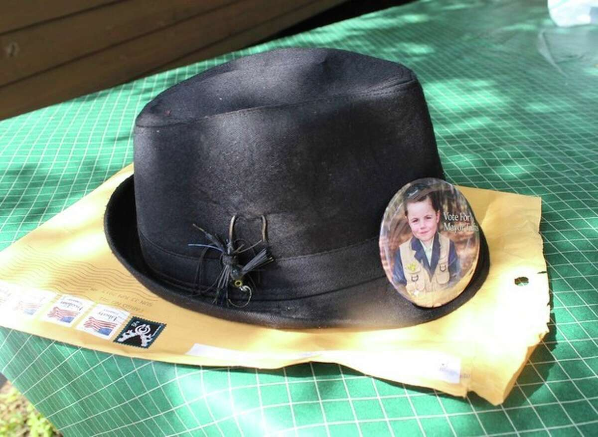 In this photo made Wednesday, June 26, 2013 in Dorset , Minn., the campaign hat of Bobby Tufts, the small town's 4-year-old mayor, sits on a table. Bobby is seeking re-election. (AP Photo/Jeff Baenen)