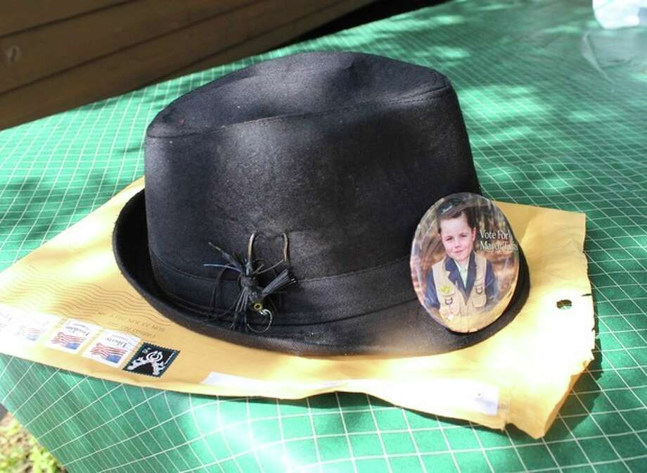 In this photo made Wednesday, June 26, 2013 in Dorset , Minn., the campaign hat of Bobby Tufts, the small town's 4-year-old mayor, sits on a table. Bobby is seeking re-election. (AP Photo/Jeff Baenen) / AP