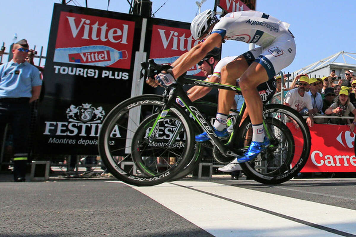 Marcel Kittel of Germany, front, crosses the finish line ahead of Mark Cavendish of Britain, rear, to win the twelfth stage of the Tour de France cycling race over 218 kilometers (136.2 miles) with start in in Fougeres and finish in Tours, western France, Thursday July 11 2013. (AP Photo/Peter Dejong)