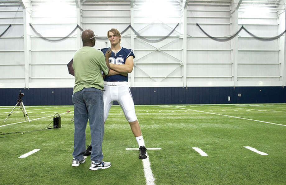 Connecticut's Andreas Knappe, right, of Denmark, is interviewed during an NCAA college football media day in Storrs, Conn., Friday, Aug. 10, 2012. (AP Photo/Jessica Hill) / FR125654 AP