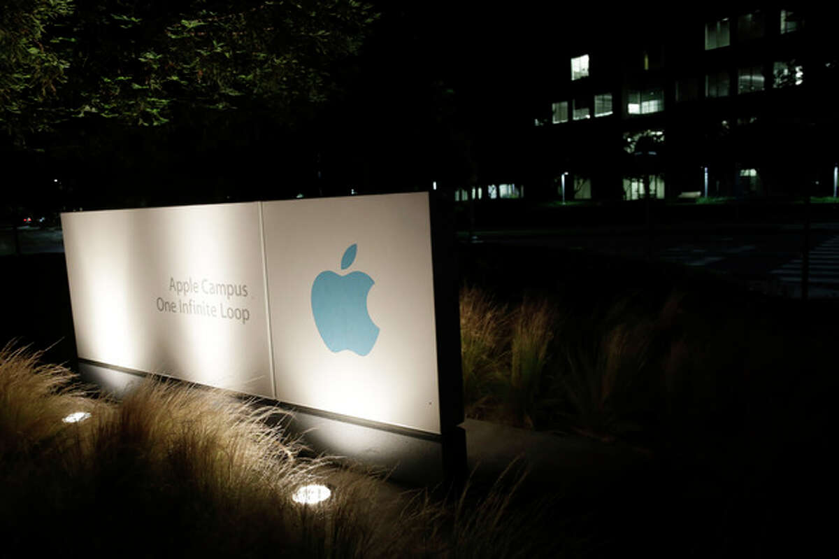 """FILE - In a Friday, June 7, 2013 file photo, a sign displays the Apple logo outside of the company's headquarters in Cupertino, Calif. A federal judge ruled Wednesday, July 10, 2013 that Apple Inc. broke antitrust laws and conspired with publishers to raise electronic book prices, citing """"compelling evidence"""" from the words of the late Steve Jobs. U.S. District Judge Denise Cote said Apple knew that no publisher could risk acting alone to try to eliminate Amazon.com's $9.99 price for the most popular e-books so it """"created a mechanism and environment that enabled them to act together in a matter of weeks to eliminate all retail price competition for their e-books.""""Apple spokesman Tom Neumayr said the Cupertino, California-based company planned to appeal. (AP Photo/Marcio Jose Sanchez, File)"""