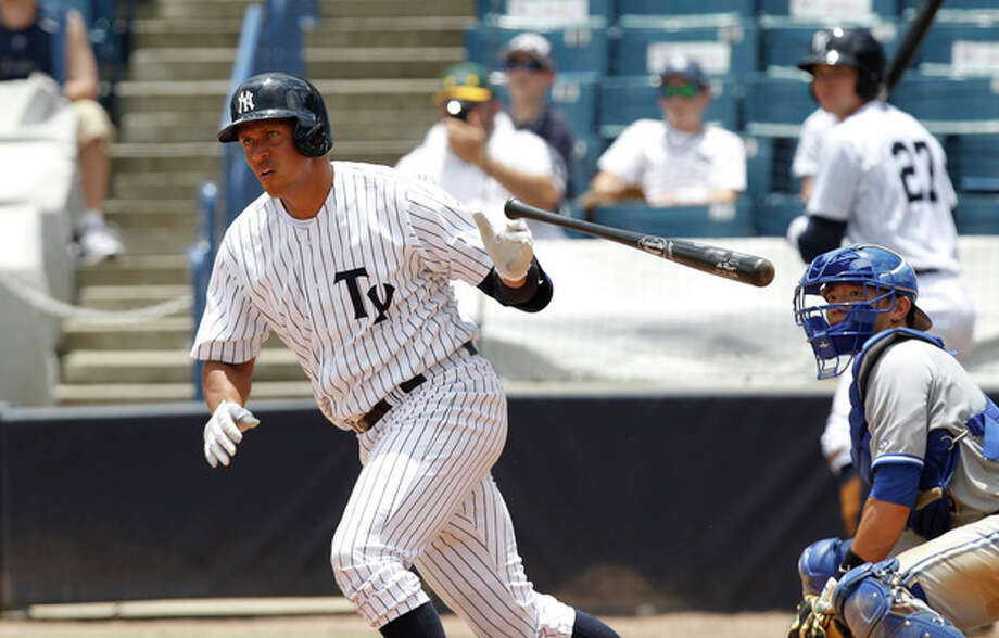 New York Yankees' Alex Rodriquez drops the bat as he heads for first with a single in the sixth inning for the Tampa Yankees against the Dunedin Blue Jays in a minor league baseball rehab game in Tampa, Fla., Wednesday, July 10, 2013. (AP Photo/Scott Iskowitz) / FRE170674 AP